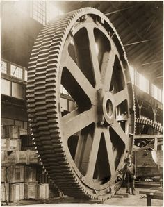 Mesta Machine Company employee stands next to a molded staggered tooth gear at the company's West Homestead facility, 1913. Description from pinterest.com. I searched for this on bing.com/images