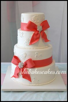 Ribbons, Bows, Brooches & Lace. #weddingcake #coral #shebakescakes