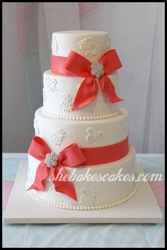 Ribbons, Bows, Brooches & Lace. #weddingcake #coral #shebakescakes