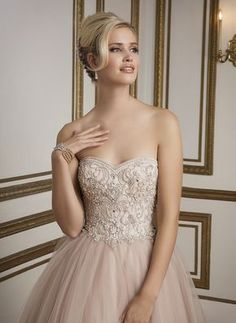 Sweetheart beaded bodice, natural waistline and tulle ball gown skirt with tiers of beaded trim. A classic, elegant gown rich in color. https://www.justinalexanderbridal.com/wedding_dresses/8847