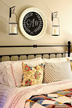 DIY Master Bedroom Ideas with monogram chalkboard, ikea duvet cover, spray painted headboard in mast