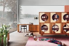 Zero sideboard with OBLO' doors made of walnut and maple. design by MAAM