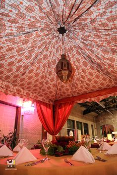 Textile canopy with a gold lantern covering a table. Gold Lanterns, Moroccan Theme, Draping, Valance Curtains, Event Planning, Canopy, A Table, How To Plan, Home Decor