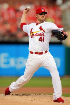 Starting pitcher John Lackey throws during the first inning against the Cincinnati Reds in St. Louis. 8-19-14