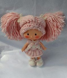 My custom pink Strawberry Shortcake doll in knitted outfit and shoes, plus crocheted wig.