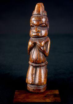 Nigeria. Benin. Kneeling female figure with a headress.