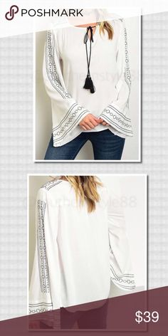 Bell Sleeve Keyhole Tassel Blouse Large BNWT 100% Rayon, bell sleeve embroidered keyhole blouse, black & white. Large. ⛔️No PP/Trades ✅Offers Considered ✅Bundle for more Discounts! Thanks for Looking! Boutique Tops Blouses