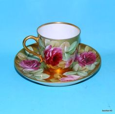 similar to mine,ART NOVEAU ANT. GINORI ITALY D.PILA GOLD PAINTED PORCELAIN DEMITASSE CUP SAUCER, sold 119$ ebay, seller bohner40