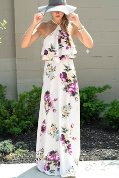 Put the FAB in fabulous with this fun floral maxi dress! It has such a flatting fit with a trendy halter style neckline, ruffle top, & cute cutout side detailing