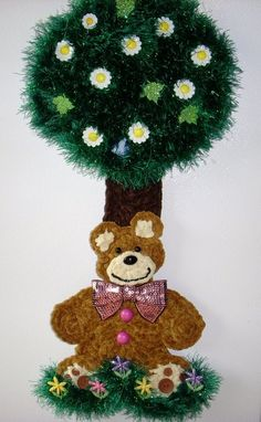 Crochet Teddy bear sitting under a tree, by Jerre Lollman