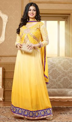 Look elegant dressed like Ayesha Takia in this ombre dyed yellow shade faux georgette long kalidar suit. Simplistic charm is flaunted through the embroidered foliage patterns on the yoke and hemline patch. #FloorlengthAnarkaliDress