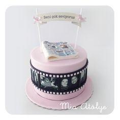 40th birthday cake with film ribbon, paper banner and fondant newspaper
