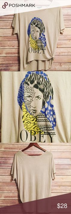 Unique Art Deco Shirt Super Cute Unique top!! Royal Blue, black and yellow on a cream Backround. Loose fitting, Tied up on the side but can be taken out. Only wore 2xs in Good condition! Obey Tops Tees - Short Sleeve