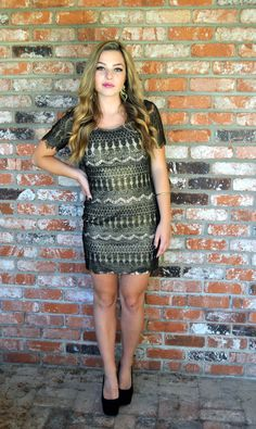 gold and black mini with lace sleeves