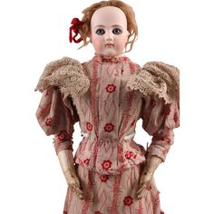 This beautiful First Series 21 Jumeau Portrait Fashion Poupee, circa 1870-1880, still has the original stamp on her body marked La Galerie  Vivienne