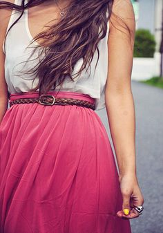 pink skirt with white tucked in shirt.