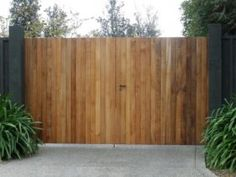 Cedar Clad Gates fastened to an Aluminium Frame