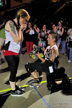 Sk8 Crime proposes to her girlfriend, Hop Devil, at their last game for the Cincinnati Rollergirls. Photo by Jason Bechtel.