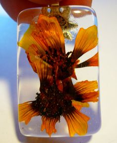 Beautiful Orange Montana Wild Flower Pendant. Preserved  in Crystal Clear Resin Rectangle. Hand made in Montana One of a kind