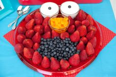 It's Elmo made of fruit!  What a great idea for a little one's party!