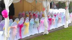 pastel multi wedding | Multicoloured pastel sashes for wedding chair cover hire