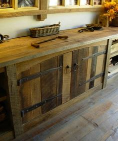 Barn Wood Cabinets - 11 Ways to Use Salvaged Wood in Your Home - Bob Vila I love the reclaimed wood wall Reclaimed Wood Projects, Reclaimed Wood Furniture, Salvaged Wood, Pallet Furniture, Rustic Furniture, Reclaimed Lumber, Repurposed Wood, Modern Furniture, Western Furniture