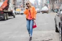 NEW YORK, NY - FEBRUARY 15: Xenia van der Woodsen wearing an orange Open Ceremony bomber jacket, denim jeans outside Michael Kors on February 15, 2017 in New York City. (Photo by Christian Vierig/Getty Images) via @AOL_Lifestyle Read more: https://www.aol.com/article/lifestyle/2017/02/16/nyfw-street-style-day-7/21715589/?a_dgi=aolshare_pinterest#fullscreen