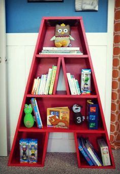 "The Letter ""A"" bookshelf knocks our socks off! Great for a kids room or playroom! Bookshelves Kids, Bookcase, Crate Bookshelf, Bookshelf Ideas, Nursery Bookshelf, Nursery Storage, Nursery Letters, Boy Room, Room Kids"