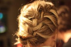 Side French Braid Bun    Stylish high braid, inclined towards a side in slanting manner for a bit diagonal alignment.
