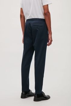 Model side image of Cos drawstring twill tailored trousers in blue