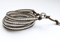 This wrap is made with metallic Kansa leather, faceted Czech fire-polished glass beads in pearl, and a very sparkly 13mm rhinestone closure. It's perfect for a dressy occasion or just jeans.