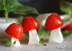 Caprese salad mushrooms: mozzarella cheese stems, grape tomato caps and basil for grass