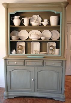 LOVE THE POP OF COLOR IN THE TRIM. grey/blue painted buffet with white pottery/dishes More of my collection of white stoneware. Love, Love, Love.