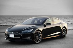 "The newly unveiled Tesla Model S is even more futuristic than its predecessor. Dubbed the Tesla Model S but nicknamed the ""Tesla D,"" it features a dual Tesla Motors, Tesla Model S Black, Nicola Tesla, New Tesla, Elon Musk, Car Shop, Fuel Economy, Police Cars, Electric Cars"