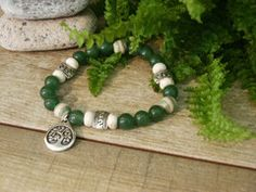 AVENTURINE   Semi precious stone stretch bracelet comes with a vial of Essential oil and is placed in a decorative tin and a card describing the Stone & essential oil.This bracelet comes with a Tree of life charm.