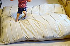 Sensory hack for kids: how to make a DIY no sew crash mat using items from around the house from And Next Comes L