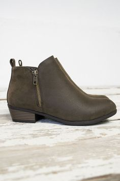 """Amazing ankle bootie heels for any dress or jeans. Super cute with a heel that measures 1.5"""" at the highest heel point. Zippers on both sides of shoe. Neutral in color to go with any amazing outfit yo"""