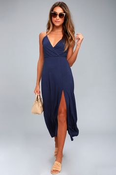 Take the Time to Tango Navy Blue Midi Dress out for a twirl! Jersey knit midi dress with adjustable straps, a surplice bodice, and midi skirt with twin slits at front.