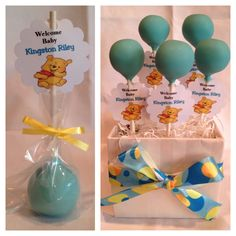 Baby blue cake pops with Winnie the Pooh favor tags and yellow ribbon.