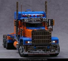 US Truck 5 (Custom Peterbilt :: A LEGO model of a custom Peterbilt 379 with a blue and orange color scheme and loads of chrome in scale It features PF, lights, driving, steer. Lego Cars, Lego Truck, Lego Trains, Custom Peterbilt, Peterbilt 379, Lego Police, Lego Pictures, Lego Builder, Lego Construction