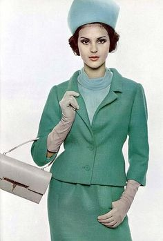 """Wearing a sea-green wool suit worn with a pale-blue mousseline blouse by Guy Laroche with gloves and handbag by Hermès, 1963."" #vintage #fashion #1960s #green"