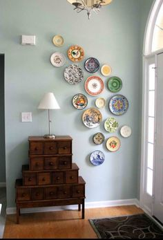 Not crazy about the color scheme, but I love the plates in the entryway