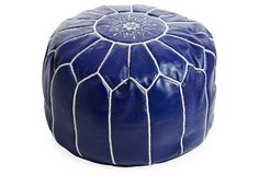 A stylish and utterly versatile home accessory, this classic pouf is handmade in Morocco using supple leather upholstery ornamented with vibrant hand-stitched motifs. Filled with durable cotton...