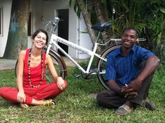 "Rita, our newest ""Voluntourist"" with Vicente  #Mozambikes #voluntourism #Mozambique #bicycles #bicicletas #Mocambique #volunteer #donate"