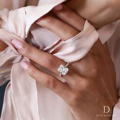 PRISCILLA is a custom engagement ring with strong lines of a 5.00+ Carats Radiant Cut center stone set in Platinum combined with the soft tone of 18K Rose Gold, handcrafted by Jean Dousset.