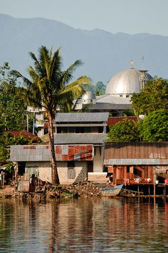 manokwari indonesia | Water village and mosque, Manokwari, West Papua, Indonesia. Manokwari ...