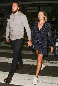 Margot Robbie traveled back from her wedding Down Under wearing the cute dress and sneakers fashion girls are obsessed with. Shop her outfit here.