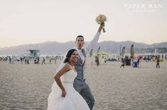 Nothing makes us smile more than seeing a #newlywed stroll along Santa Monica Beach. #weddings #WeddingWednesdays