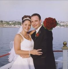 The bride and groom pose for a quick picture on the deck of this Yacht overlooking Newport Harbor. Newport Beach, Newport Harbor, Boat Wedding, Yacht Wedding, Groom Poses, Bridesmaid Dresses, Wedding Dresses, Bride Groom, Deck