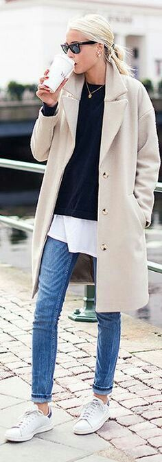 Long below crotch white with sweater jeans and beige or camel coat